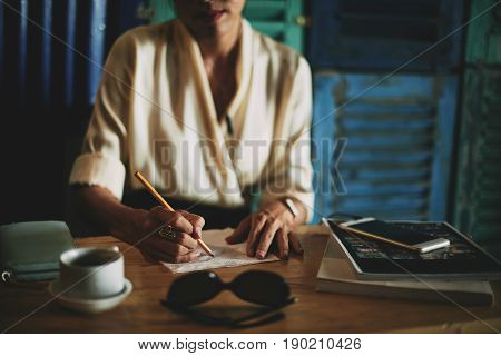 Close-up image of business lady drawing ideas on a napkin, selective focus