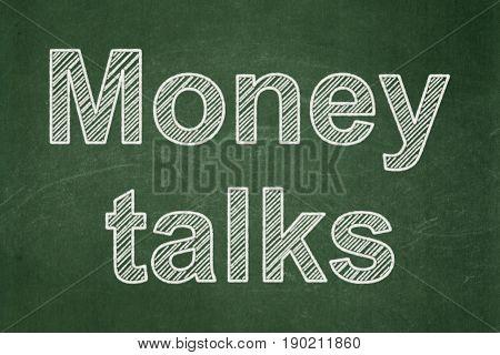 Finance concept: text Money Talks on Green chalkboard background