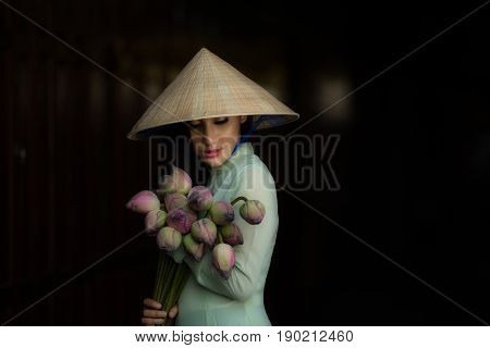Women vietnam in Ao dai Traditional dress of Vietnam with lotus flower poster
