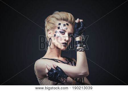 Woman Beautiful Model With Body Art Of Unusual And Fashionable Clothing In The Studio