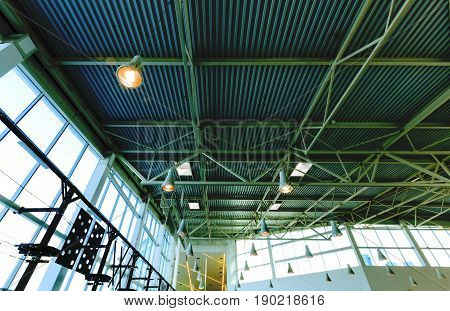 Ceiling constuction with lamps and big windows generic horizontal view