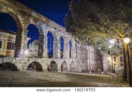 Partial View Of The Roman Aqueduct Located In The City Of Segovia At Night , Unesco World Heritage S