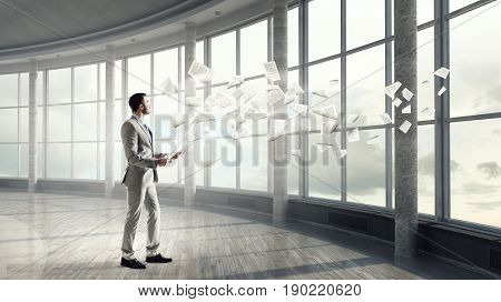 Handsome busy businessman making notes
