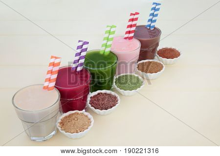 High protein and health supplement super food drinks of maca root herb, acai berry, wheat grass, pomegranate fruit and chocolate whey. Also used by body builders.