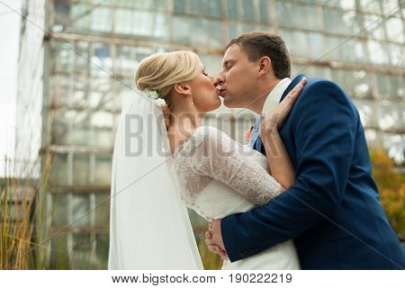 A Look From Above On The Fiance In Blue Suit Kissing An Elegant Bride