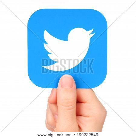 Kiev Ukraine - January 20 2017: Hand holds Twitter icon printed on paper. Twitter is a well-known social networking and news service