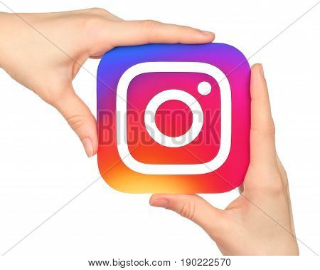 Kiev Ukraine - January 20 2016: Hands hold Instagram icon printed on paper. Instagram is an online mobile photo-sharing video-sharing service
