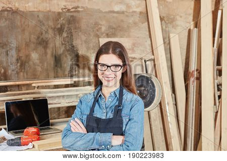 Portrait of satisfied woman as carpenter trainee