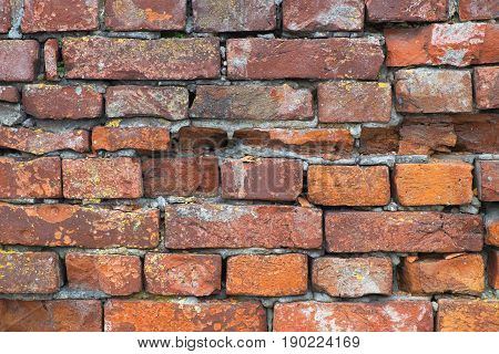 Fragment of the old brick fortress wall. Architecture fortification exterior