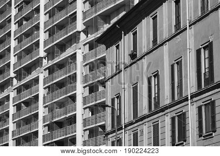 Milan (Lombardy Italy): facade of modern and old buildings along via Francesco Ferruccio. Black and white
