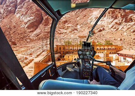 Helicopter cockpit aerial view of the Monastery of St. Catherine, the oldest Christian Monastery located on the slopes of Mount Horeb, Sinai Peninsula in Egypt.