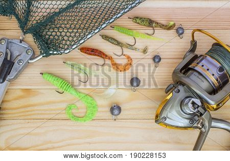 Silicone spoon-baits with a sachet and a spinning coil