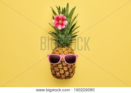 Fashion Hipster Pineapple Fruit. Bright Summer Color, Accessories. Tropical pineapple with Sunglasses. Creative Art concept. Minimal style. Summer party Yellow background