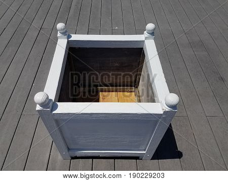 white wood planter box on wood deck