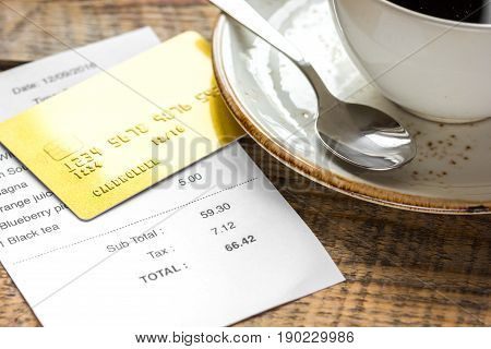 Paying Check For Lunch With Card Wooden Table Background