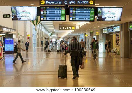 Passenger looking at the departure timetable in the Ben Gurion International Airport stock image. Tel Aviv, Israel. December 2014.