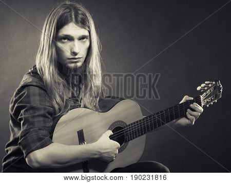 Guitarist Is Playing The Guitar.