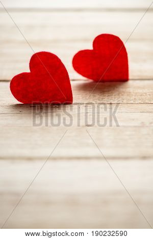 Two Red Hearts Lying On Wooden Table. St Valentine Day Decorations