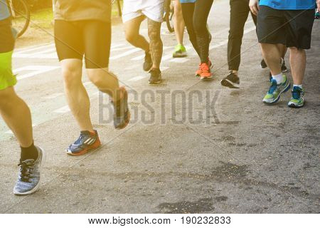 Group Of People Running In Public City Park