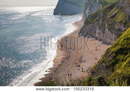 british seaside - summer holiday destination - Durdle Door at the beach on the Jurassic Coast of Dorset, UK