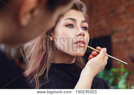 Applying Lipgloss With A Brush