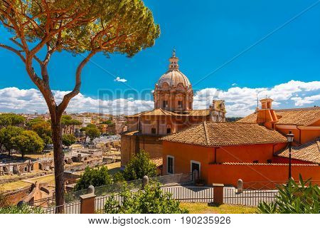 The Baroque church of Santi Luca e Martina with the remains of the Roman Forum in the sunny day in Rome, Italy