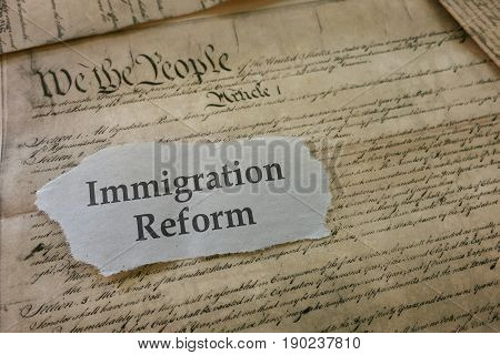 Immigration newspaper headline on copy of US Constitution