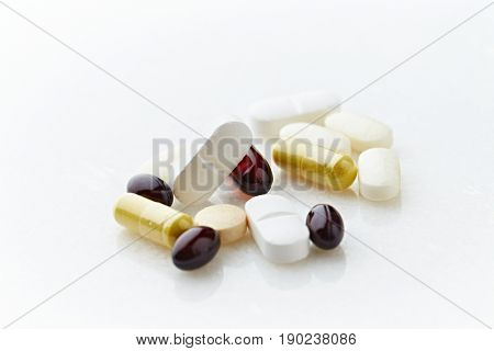 Assorted natural diet supplements on white background