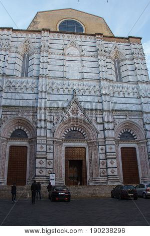 Italy Siena - December 26 2016: the view of San Giovanni Baptistery facade on Piazza del Campo on December 26 2016 in Siena Tuscany Italy.