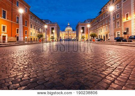 View of The Papal Basilica of St. Peter in the Vatican or Saint Peter Cathedral during morning blue hour in Rome, Italy.