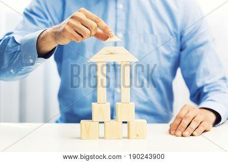 concept of businessman build his business empire