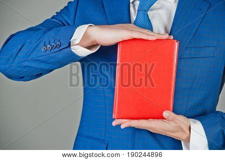 Notebook In Hand Of Man, Businessman In Blue Outfit