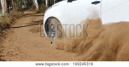 Rally Car turning in dirt track,,dust splash