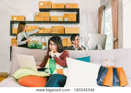 Group of young Asian people working on small business startup at home office online marketing shopping and packaging delivery or freelance teamwork concept