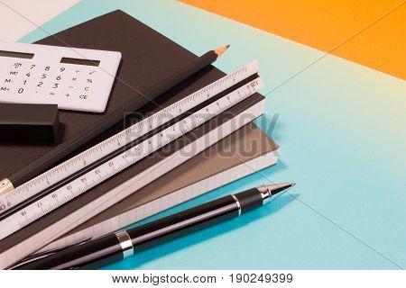 Modern School Office Desk Table With Modern School Supplies Book, Pen Ruler And Calculator. School O