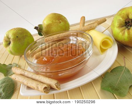 Appetizer with quince chutney, breadsticks and cheese
