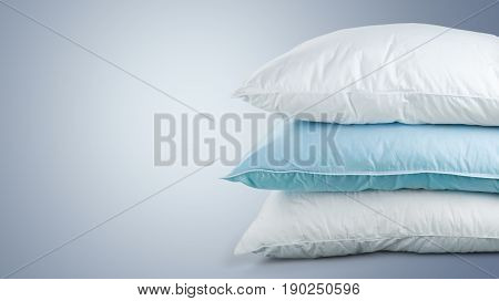 Soft pile pillows close up white objects background