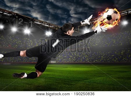 Soccer or football goalkeeper catching ball on stadium