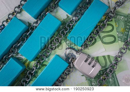 Chains with combination padlock and colorful wooden block as safety banking block chain concept.