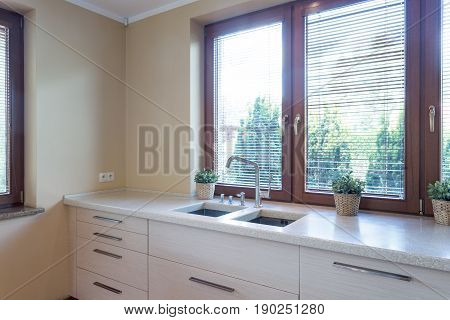 Kitchen With Marble Kitchentop With Sink