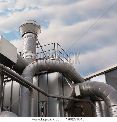 Industrial factory air filtration system. Tubes tank and chimney.