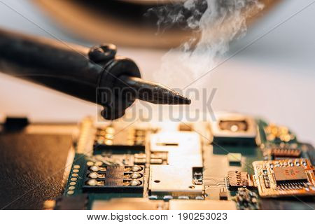 Repair of a broken mobile phone in the workshop