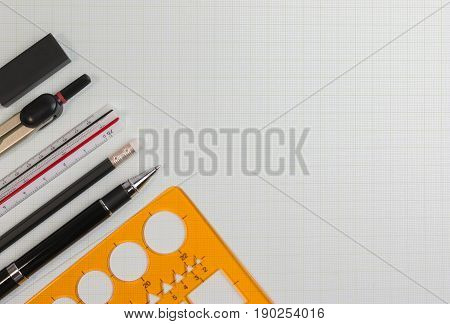 Mathematics office supplies or architect desktop with drawing tools plastic template ruler, pen, pencil, eraser. Geometry mathematics class concept with copy space.