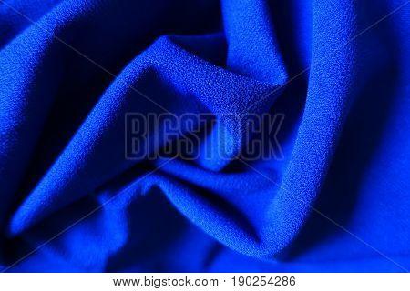 Draped bright electric blue fabric (in swirls)