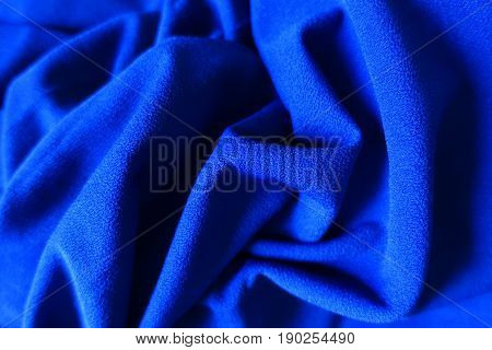 Draped very bright electric blue smooth cloth