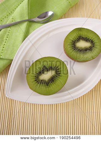 Fruit meal with kiwifruits on plate on table