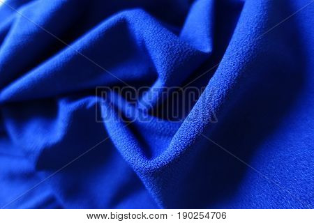 Draped bright electric blue smooth fabric with shades