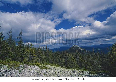 Carpathian mountains summer landscape with dramatic sky and rocks