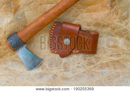 Tomahawk constructed from a horseshoeing rasp displayed along with leather sheath