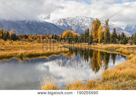 a scenic autumn reflection landscape in Teton National Park Wyoming